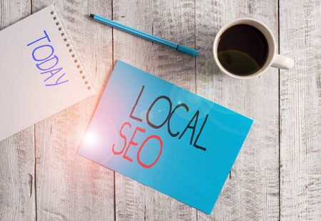 Writing note showing Local Seo. Business concept for helps businesses promote products and services to local customers Stationary placed next to a cup of black coffee above the wooden table Reklamní fotografie
