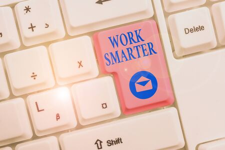 Word writing text Work Smarter. Business photo showcasing figuring out order to reach goals in the most efficient way White pc keyboard with empty note paper above white background key copy space Reklamní fotografie