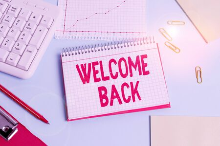 Handwriting text Welcome Back. Conceptual photo something back to greet the return of someone or something Paper blue desk computer keyboard office study notebook chart numbers memo Stok Fotoğraf