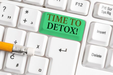 Conceptual hand writing showing Time To Detox. Concept meaning when you purify your body of toxins or stop consuming drug White pc keyboard with note paper above the white background Stock Photo
