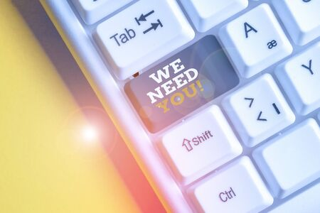 Text sign showing We Need You. Business photo text to fulfill the needs of the assignment duty or obligation White pc keyboard with empty note paper above white background key copy space