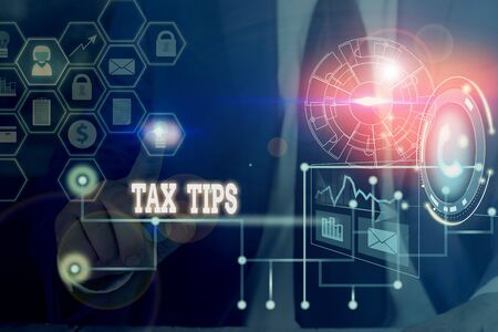 Conceptual hand writing showing Tax Tips. Concept meaning compulsory contribution to state revenue levied by government Picture photo network scheme with modern smart device Stok Fotoğraf