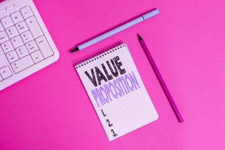 Conceptual hand writing showing Value Proposition. Concept meaning feature intended to make a company or product attractive Writing equipments and computer stuff placed on plain table