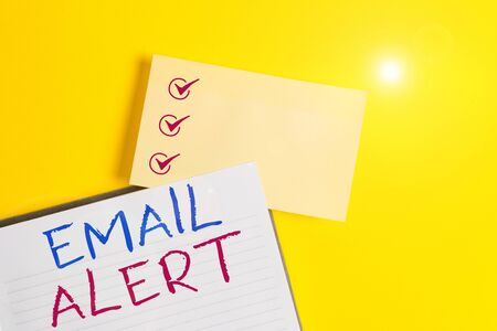Conceptual hand writing showing Email Alert. Concept meaning emails auto generated nd sent to designated recipients Empty orange paper with copy space on the yellow table