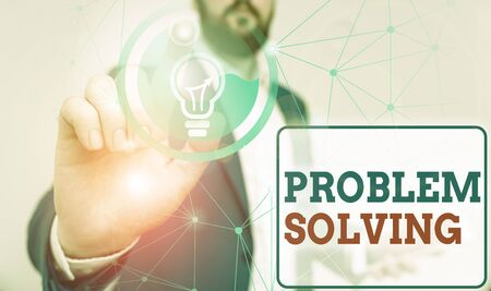 Writing note showing Problem Solving. Business concept for process of finding solutions to difficult or complex issues Male human wear formal suit presenting using smart device