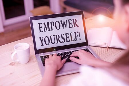 Word writing text Empower Yourself. Business photo showcasing taking control of our life setting goals and making choices woman laptop computer smartphone mug office supplies technological devices Imagens