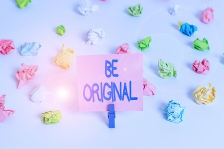 Writing note showing Be Original. Business concept for created directly and demonstratingally by an artist Not a imitation Colored crumpled paper empty reminder white floor clothespin