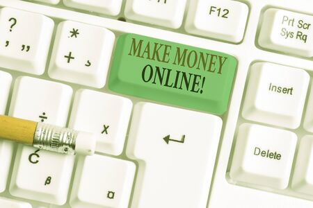 Conceptual hand writing showing Make Money Online. Concept meaning making profit using internet like freelancing or marketing White pc keyboard with note paper above the white background Reklamní fotografie