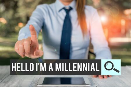 Handwriting text writing Hello I M A Millennial. Conceptual photo demonstrating reaching young adulthood in current century Female business person sitting by table and holding mobile phone