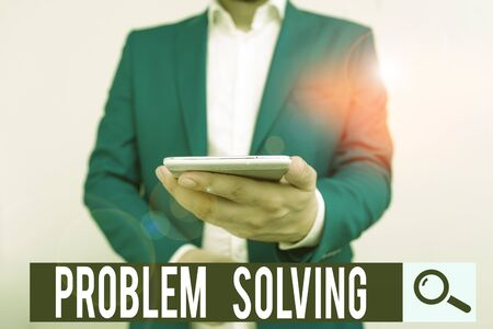 Writing note showing Problem Solving. Business concept for process of finding solutions to difficult or complex issues Business concept with man holding mobile phone with touch screen 版權商用圖片