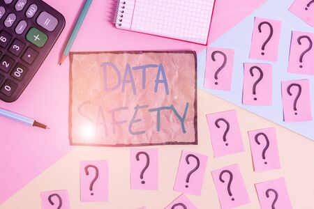 Writing note showing Data Safety. Business concept for concerns protecting data against loss by ensuring safe storage Mathematics stuff and writing equipment above pastel colours background Stock Photo