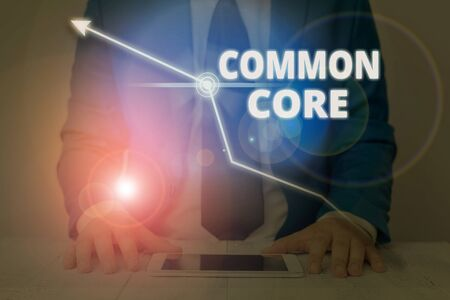 Writing note showing Common Core. Business concept for set of academic standards in mathematics and English language Stock fotó - 133427099