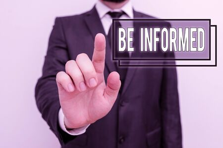 Text sign showing Be Informed. Business photo showcasing having or showing knowledge of a subjects or situations Male human with beard wear formal working suit clothes raising one hand up Standard-Bild - 133477683
