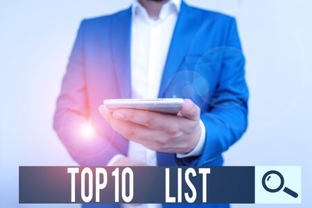 Writing note showing Top 10 List. Business concept for the ten most important or successful items in a particular list Business concept with man holding mobile phone with touch screen Stok Fotoğraf