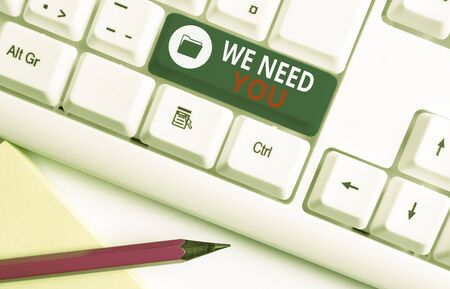 Writing note showing We Need You. Business concept for to fulfill the needs of the assignment duty or obligation White pc keyboard with note paper above the white background Reklamní fotografie