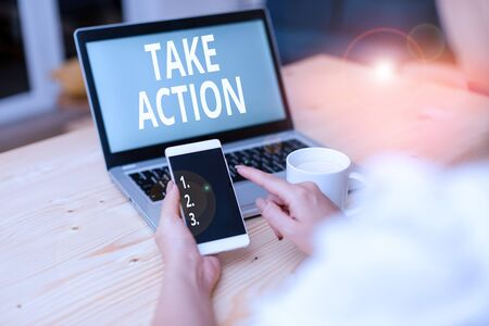 Text sign showing Take Action. Business photo text to do somethingoract in order to get a particular result woman laptop computer smartphone mug office supplies technological devices 스톡 콘텐츠