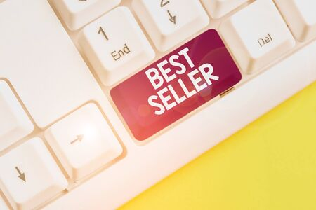 Word writing text Best Seller. Business photo showcasing new book or other product that has sold a great number of copies White pc keyboard with empty note paper above white background key copy space Stockfoto