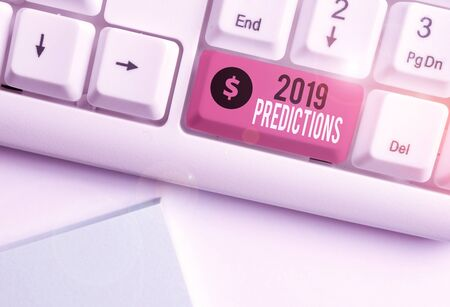 Word writing text 2019 Predictions. Business photo showcasing statement about what you think will happen in 2019 White pc keyboard with empty note paper above white background key copy space Stock Photo