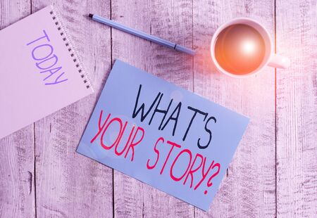 Writing note showing What S Is Your Storyquestion. Business concept for analysisner of asking demonstrating about past life events Stationary placed next to a cup of black coffee above the wooden table Stock fotó