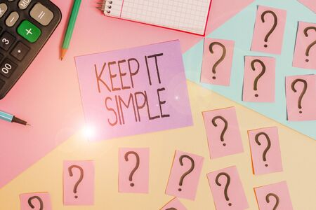 Conceptual hand writing showing Keep It Simple. Concept meaning to make something easy to understand and not in fancy way Mathematics stuff and writing equipment on pastel background