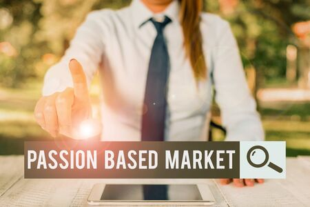 Handwriting text writing Passion Based Market. Conceptual photo Emotional Sales Channel a Personalize centric Strategy Female business person sitting by table and holding mobile phone