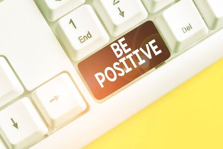 Word writing text Be Positive. Business photo showcasing giving cause for hope and confidence Without any doubt White pc keyboard with empty note paper above white background key copy space