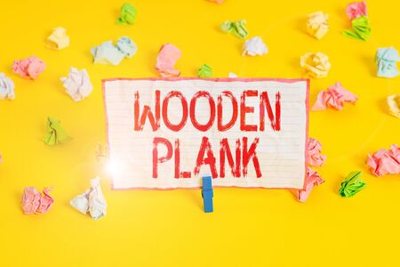 Conceptual hand writing showing Wooden Plank. Concept meaning wood or similar material of the type used for making floors Colored crumpled paper empty reminder white floor clothespin Stock fotó