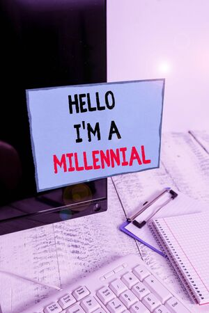 Writing note showing Hello I M A Millennial. Business concept for demonstrating reaching young adulthood in current century Note paper taped to black computer screen near keyboard and stationary