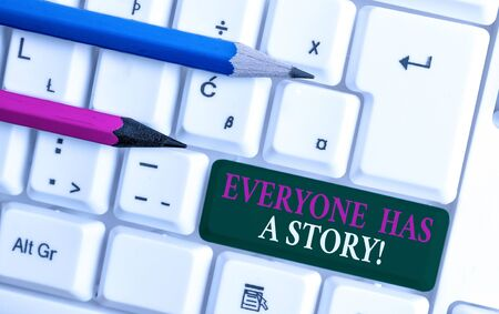 Text sign showing Everyone Has A Story. Business photo showcasing account of past events in someones life or career White pc keyboard with empty note paper above white background key copy space