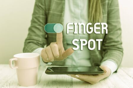 Text sign showing Finger Spot. Business photo text Small fluidfilled blisters called vesicles appear on the finger Business woman sitting with mobile phone and cup of coffee on the table