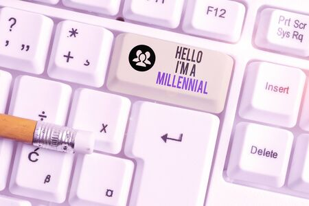 Conceptual hand writing showing Hello I M A Millennial. Concept meaning demonstrating reaching young adulthood in current century White pc keyboard with note paper above the white background