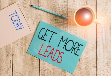 Writing note showing Get More Leads. Business concept for to have more customers and improve your target sales Stationary placed next to a cup of black coffee above the wooden table