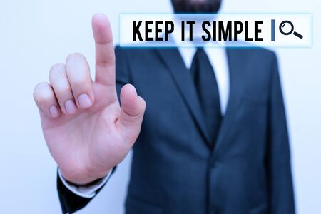 Text sign showing Keep It Simple. Business photo showcasing to make something easy to understand and not in fancy way Male human with beard wear formal working suit clothes raising one hand up Stock fotó