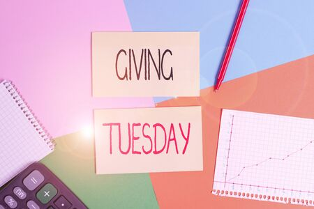 Text sign showing Giving Tuesday. Business photo showcasing international day of charitable giving Hashtag activism Office appliance colorful square desk study supplies empty paper sticker Stockfoto