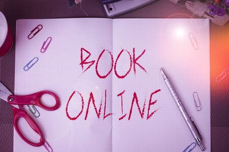Text sign showing Book Online. Business photo text booklike form that is only available to read on the Internet Scissors and writing equipments plus math book above textured backdrop