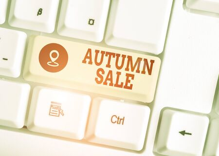 Conceptual hand writing showing Autumn Sale. Concept meaning having great discounts products on season after summer White pc keyboard with note paper above the white background