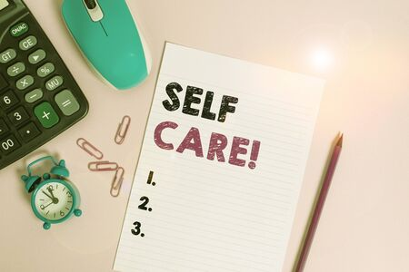 Word writing text Self Care. Business photo showcasing the practice of taking action to improve one s is own health Calculator clips alarm clock mouse sheet pencil colored background Stock fotó