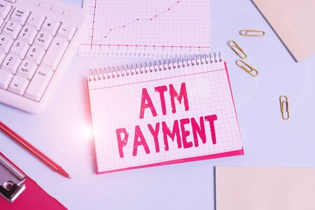 Handwriting text Atm Payment. Conceptual photo Cashless Payment made through portable electronic devices Paper blue desk computer keyboard office study notebook chart numbers memo Imagens
