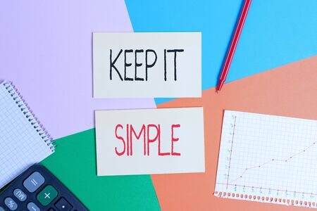 Text sign showing Keep It Simple. Business photo showcasing to make something easy to understand and not in fancy way Office appliance colorful square desk study supplies empty paper sticker Stock Photo
