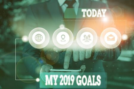 Text sign showing My 2019 Goals. Business photo showcasing setting up demonstratingal goals or plans for the current year Picture photo system network scheme modern technology smart device