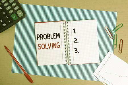 Text sign showing Problem Solving. Business photo text process of finding solutions to difficult or complex issues Striped paperboard notebook cardboard office study supplies chart paper