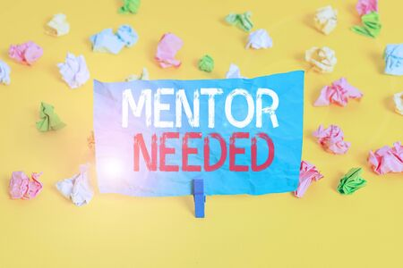 Conceptual hand writing showing Mentor Needed. Concept meaning wanted help for more experienced or more knowledgeable demonstrating Colored crumpled paper empty reminder white floor clothespin