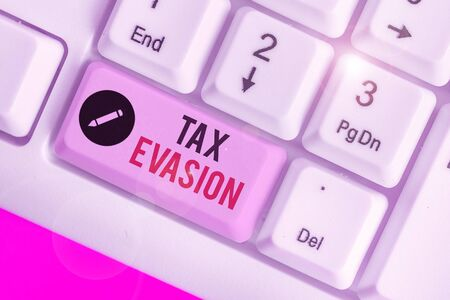 Handwriting text writing Tax Evasion. Conceptual photo the failure to pay or the deliberate underpayment of taxes Stock Photo