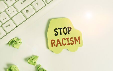 Handwriting text writing Stop Racism. Conceptual photo end the antagonism directed against someone of a different race Green note paper in the shape of the car. Copy space on the green note paper