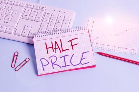Conceptual hand writing showing Half Price. Concept meaning half the usual price at which something is offered for sale Paper blue keyboard office study notebook chart numbers memo