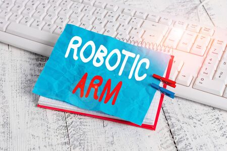 Word writing text Robotic Arm. Business photo showcasing programmable mechanical arm with similar function of a huanalysis arm notebook paper reminder clothespin pinned sheet white keyboard light wood 写真素材