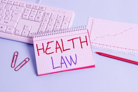 Conceptual hand writing showing Health Law. Concept meaning law to provide legal guidelines for the provision of healthcare Paper blue keyboard office study notebook chart numbers memo