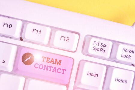 Writing note showing Team Contact. Business concept for The interaction of the individuals on a team or group White pc keyboard with note paper above the white background
