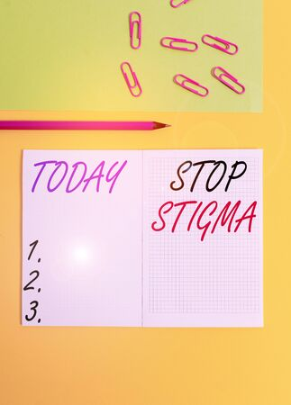 Handwriting text writing Stop Stigma. Conceptual photo end the feeling of disapproval that most showing in society have Blank squared notebook pencil marker paper sheet plain colored background