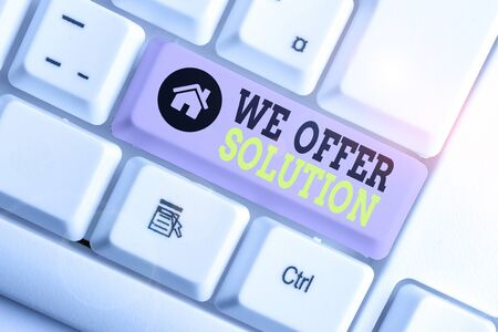 Conceptual hand writing showing We Offer Solution. Concept meaning Provide products or services aim to meet a particular need White pc keyboard with note paper above the white background 写真素材